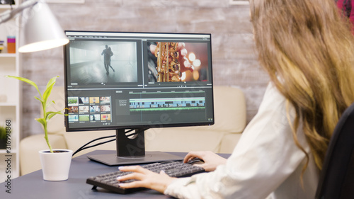 Creative female filmmaker working on post production of a movie Tapéta, Fotótapéta