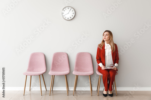 Photo Young woman waiting for job interview indoors