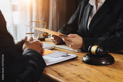 Photo business people and lawyers discussing contract papers sitting at the table