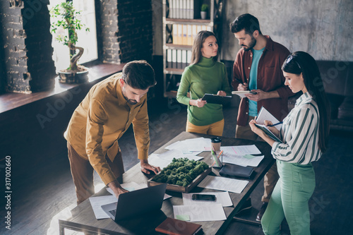Company of four nice attractive smart clever busy businesspeople managers prepar Canvas Print