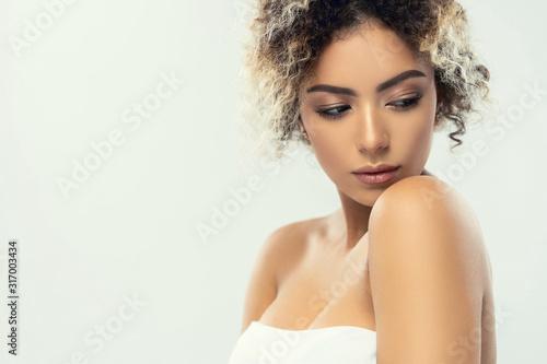 Fototapeta Beauty closeup portrait of beautiful mixed race caucasian - african american woman looking at camera obraz