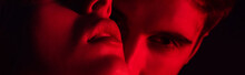 Close Up View Of Passionate Young Couple Kissing In Red Light, Panoramic Shot