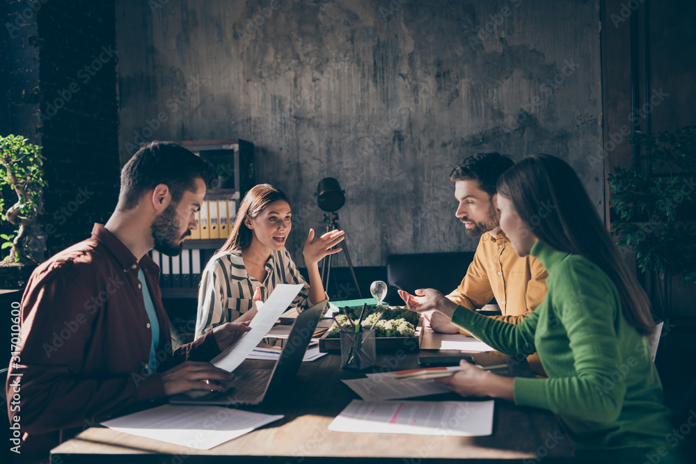 Fototapeta Skilled experienced businesspeople wearing casual formal-wear discussing IT result contract tender assignment at modern industrial loft brick style interior work place station indoors