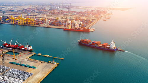 Photo Aerial view of container cargo ship in sea.