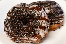 Two Stacked Donuts With Vanill...
