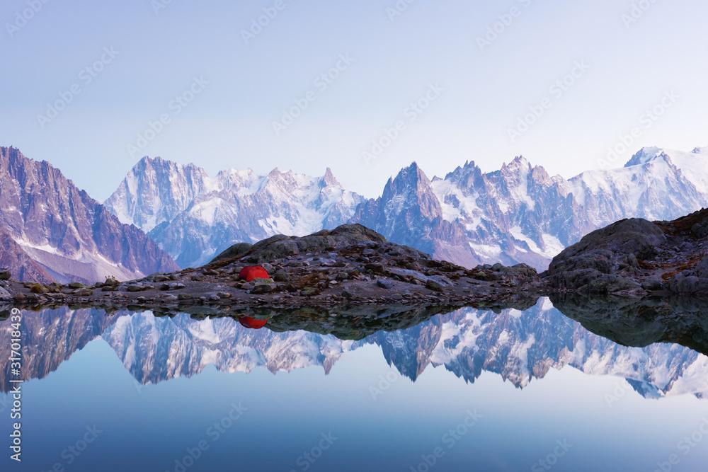 Fototapeta Red tent on Lac Blanc lake coast in France Alps. Monte Bianco mountains range on background. Landscape photography, Chamonix.