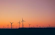 Wind Turbines Against Beautifu...