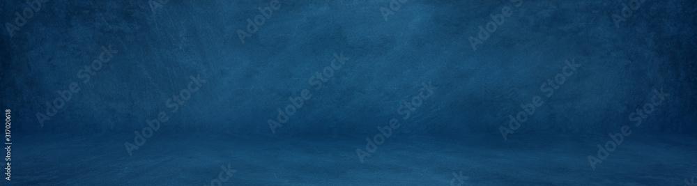 Fototapeta wide horizontal dark blue cement studio background to present product