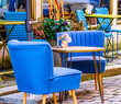 canvas print picture - table and chairs at a cafe