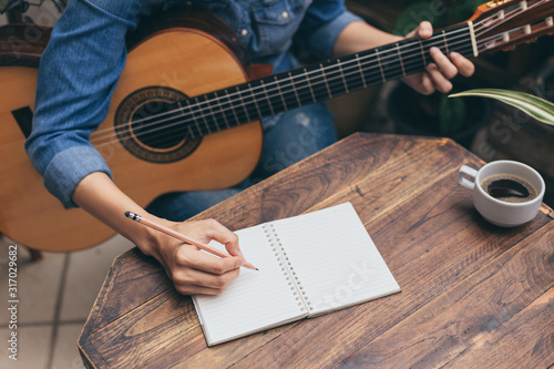 artist songwriter thinking writing notes,lyrics in book at studio Canvas Print