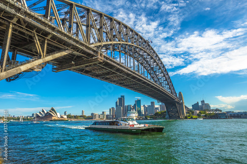 Sydney, Australia - December 29, 2014:Sydney Opera House and Harbor Bridge and city skyline with boat
