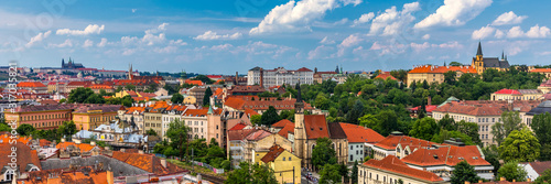 Fototapeta Praga  view-of-prague-castle-over-red-roof-from-vysehrad-area-at-sunset-lights-prague-czech-republic-scenic-view-of-prague-city-prague-castle-and-petrin-tower-from-vysehrad-overlooking-red-roofs