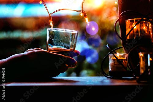 whisky shot glass at bar counter. Canvas Print