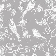 Seamless Pattern In Oriental Style With Blooming Branches Trees And Birds. Wildlife Silhouette, White Floral Ornament On Gray Background. Vector Hand Drawn Illustration, Garden In Japanese Style.