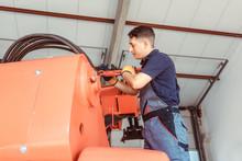 Technician Doing Some Maintenance Work On Farm Machine