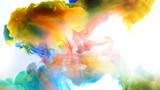 Fototapeta Tęcza - Color paint drops in water , abstract color mix , drop of Ink color mix paint falling on water Colorful ink in water,