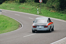 Blur Background Old Vinatge Retro European Race Car On The Road Back View