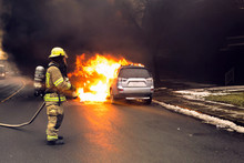 Firefighter Extinguish A Car F...