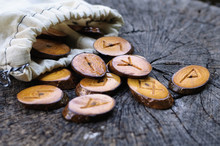 Wooden Runes In A Bag On An Ol...