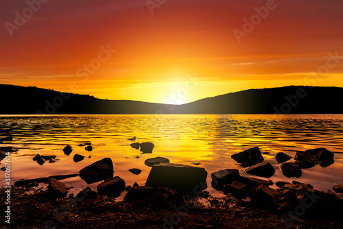 The orange glow of the sunset as it sets over Devil's Lake in Baraboo, Wisconsin, USA.