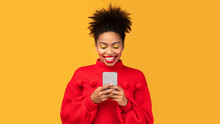 Smiling Afro Girl Using Cell P...