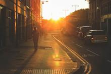 Street Scene Of People Walking...