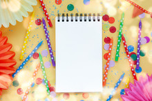 Empty Paper Blank, Festive Birthday Colorful Candles And Paper Fans On Pastel Yellow Background.