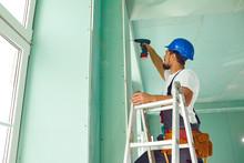 A Builder Standing On A Ladder...