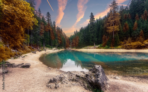 Wall mural - Wonderful sunrise view of Braies lake. Dramatic Unusual Scene. Colorful Sky over lago di Braies in Dolomites Alps. Awesome Alpine Highlands during sunset. Amazing nature Landscape at Summer Day