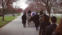 Military Funeral Procession Follow Horse Drawn Hearse For Veteran