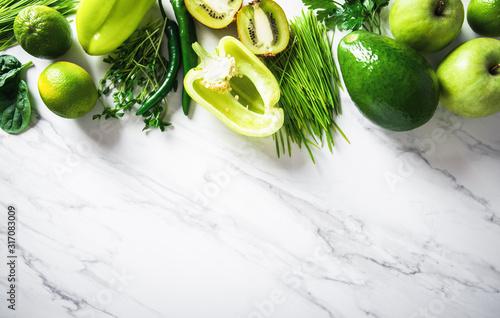 Fototapeta Fresh fruit, vegetable, greens on white marble background. Green healthy food, clean eating. Detox, dieting food. obraz