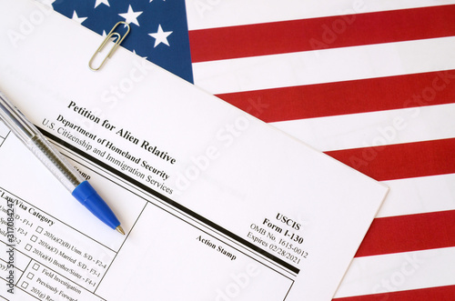 Cuadros en Lienzo I-130 Petition for alien relative blank form lies on United States flag with blu