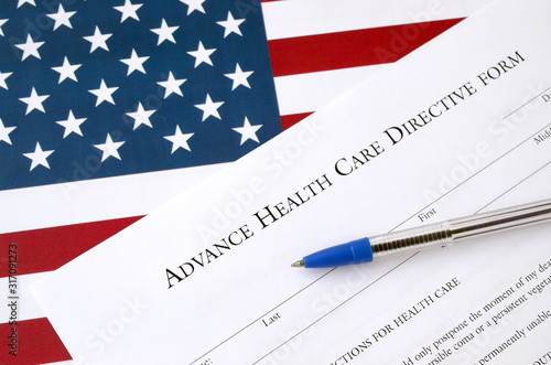 Advance health care directive blank form and blue pen on United States flag Wallpaper Mural