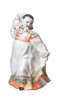 An Old Porcelain Figurine Of A...