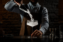 Male Bartender Putting A Crush...