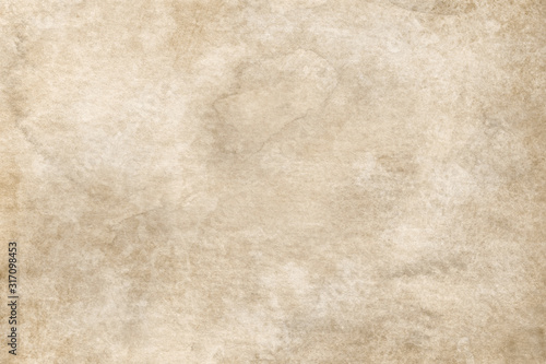 Photo Old brown paper parchment background with distressed vintage stains and ink spat