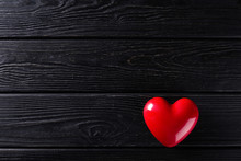 Red Heart Shape On Black Wooden Rustic Background
