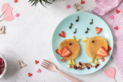 Obraz Creative idea for kids breakfast - funny pancakes shaped cute birds - fototapety do salonu