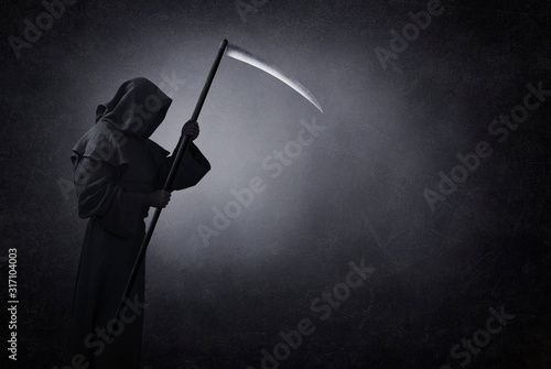 Grim reaper with scythe in the dark Wallpaper Mural