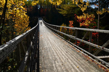 Wooden Footbridge Suspended Be...