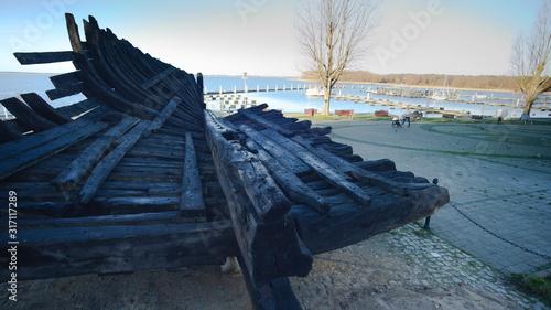 Obraz Kamien Pomorski, wreck of an old antique boat. - fototapety do salonu