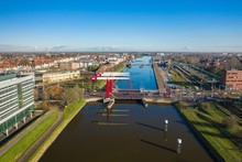High Angle Shot Of A Bridge Over The Water Surrounded By Buildings In Middelburg, Netherlands.