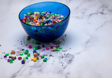 Beads Spilled On White Marble ...