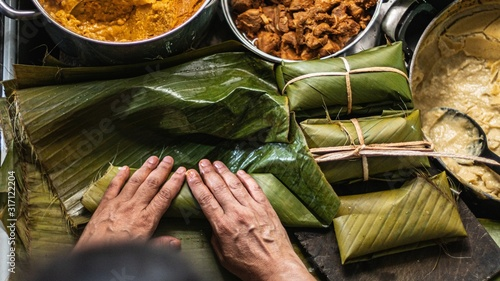 Overhead   shot of person preparing honduran tamales Wallpaper Mural