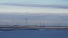 Three Wind Turbines Near Plove...