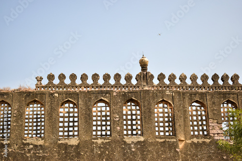 Fotografie, Obraz Old Ancient Antique Historical Ruined Architecture of Golconda Fort Walls