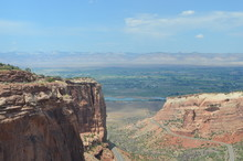 Early Summer In Colorado: Looking Out Fruita Canyon To The Colorado River, Grand Valley And The Book Cliffs From Redlands View In Colorado National Monument