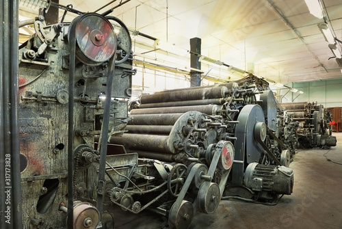 An old machine at an abandoned textile factory in the morning sun Wallpaper Mural