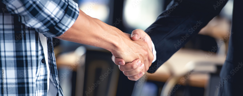 Fototapeta Professional young business people handsake, united, joining , combine hands together expressing positive, unity, volunteer , teamwork concepts.