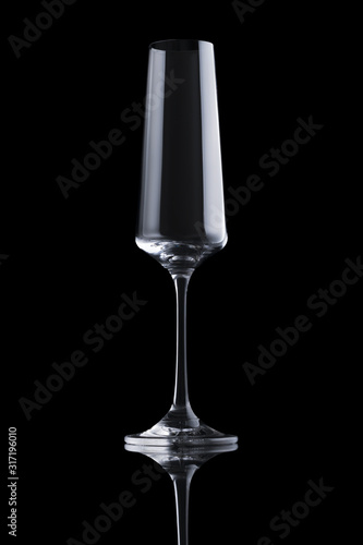 Single transparent elegant luxury empty champagne glass with rectangular harsh highlight isolated on black background Canvas Print